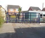 FS20 - Harlan style 8 cycle shelter for 20 cycles, with junior cycle stands