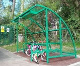 FS21 - Harlan style 13 cycle shelter, with solar lighting, end panels, and integrated scooter rack