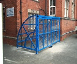 FS24 - Harlan style 8 lockable cycle shelter for 10 bikes, with sliding gates