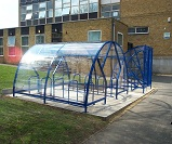 FS28 - Salisbury Minor open compound cycle shelter for 20 cycles, together with Harlan style 6 gated front cycle shelter for 6 cycles