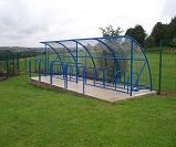 FS38 - Economy cycle shelter for 20 bikes, featuring additional safety barrier hoops