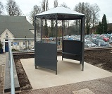 FS41 - Hexagon waiting shelter with integral bench seating