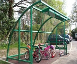 FS57 - Harlan style 12 cycle shelter for 7 bikes, with additional features of end panels, solar LED lighting, and storage for 10 scooters