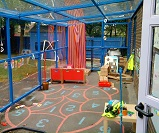 FS58 - Monopitch canopy with sidewalls, used as an external classroom/play area