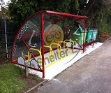 Cycle shelter and scooter rack with themed end panels