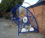 FS67 - Harlan style 10 cycle shelter for 20 cycles with themed end panels