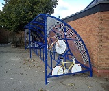 TE07 - Harlan style 10 shelter configured as a cycle shelter, with cycle themed end panels