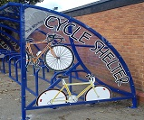 TE08 - Harlan style 10 shelter configured as a cycle shelter, with cycle themed end panels, end view